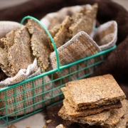 Garlic Parmesan Flax Seed Crackers in a basket