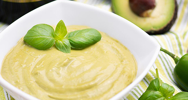 basil, jalapeno, & avocado dip in a white bowl