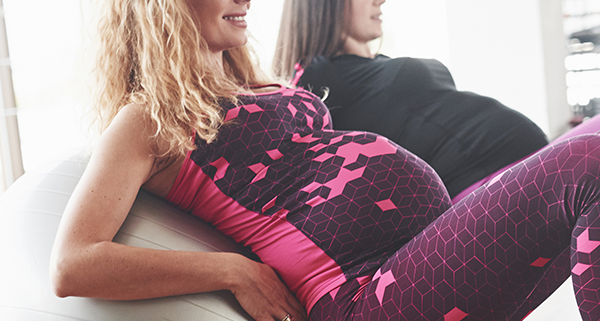two women doing prenatal yoga in london, ontario