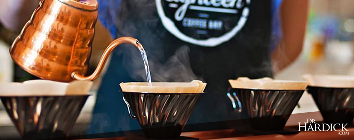 barista pouring coffee at london, ontario coffee shop