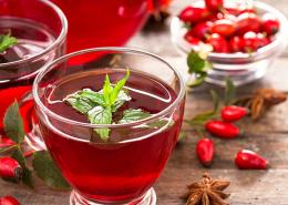organic rosehip tea in a glass mug on a wooden table