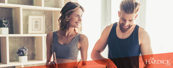 couple preparing healthy meal together in a kitchen