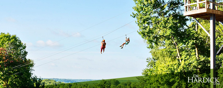 two people ziplining at boler mountain in london, ontario