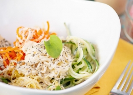 Asian vegetable noodle salad in white bowl
