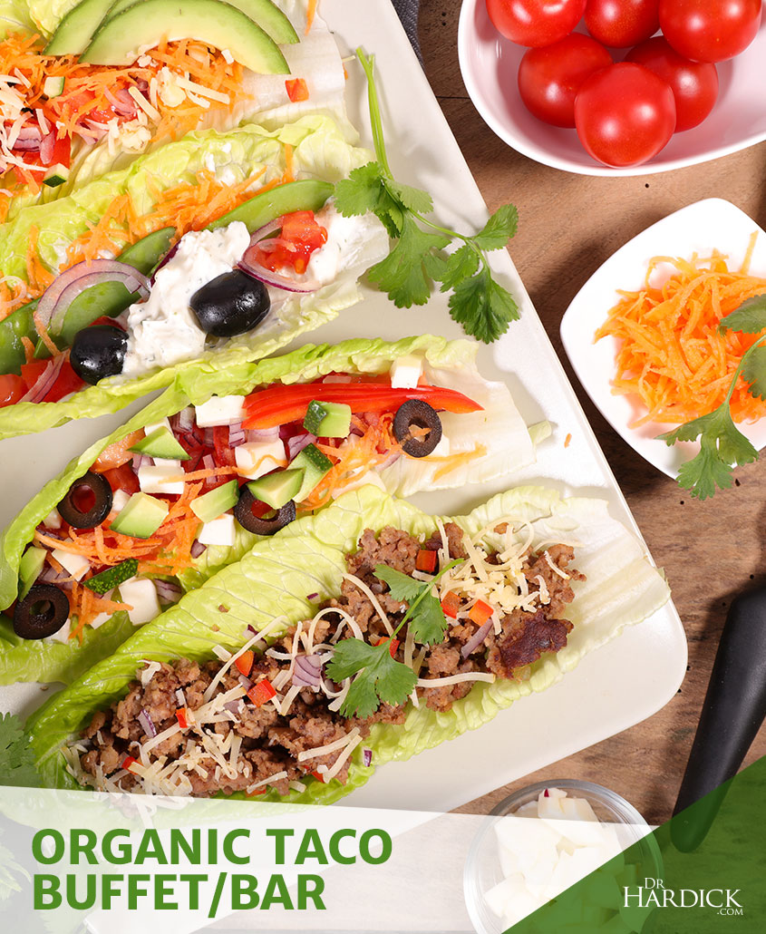 organic tacos with cheese, red onions, olives, and avocado in lettuce wraps