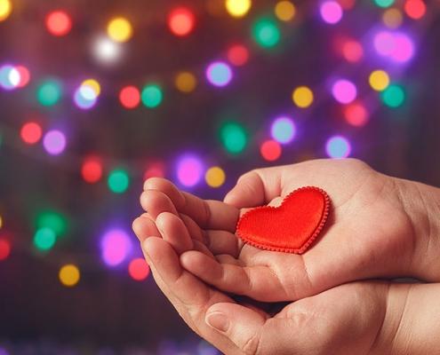hands holding a felt heart in palms