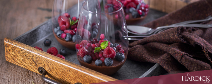 Chocolate mousse with berries in stemless wine glass